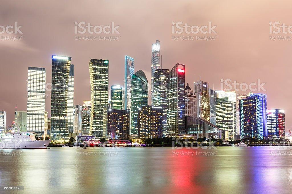Shanghai skyline and modern cityscape at night stock photo
