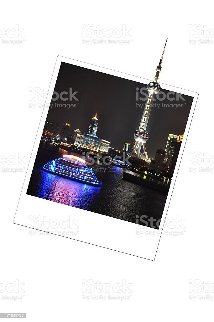 Shanghai skyline by night in a photo frame stock photo