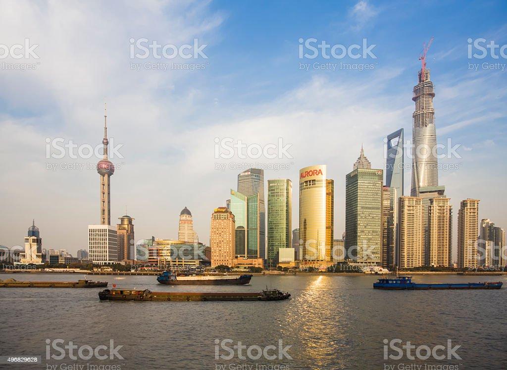 Shanghai Skyline with sand carrier and cargo ship stock photo
