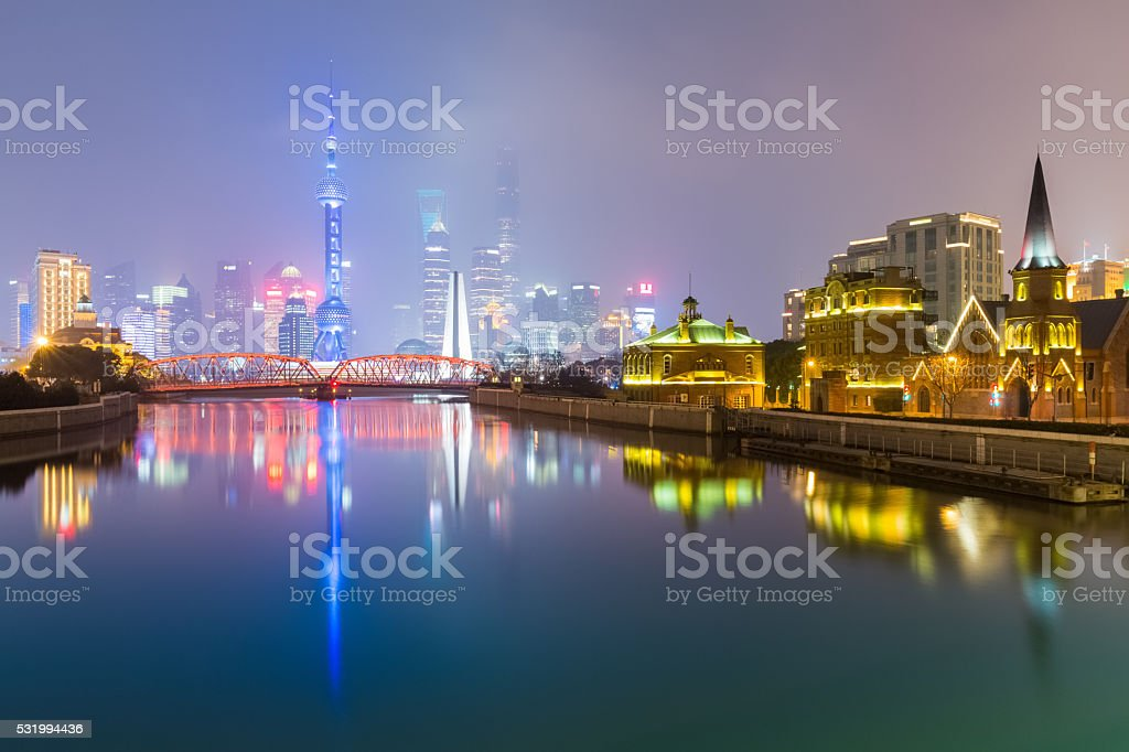 shanghai skyline with suzhou river at night stock photo