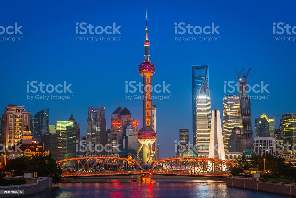 Shanghai Waibaidu bridge Pudong skyscrapers Oriental Pearl Tower illuminated China stock photo