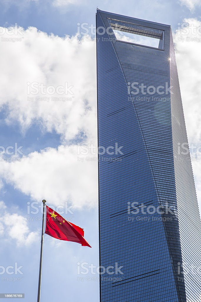 Shanghai World Financial Center and Chinese Flag royalty-free stock photo
