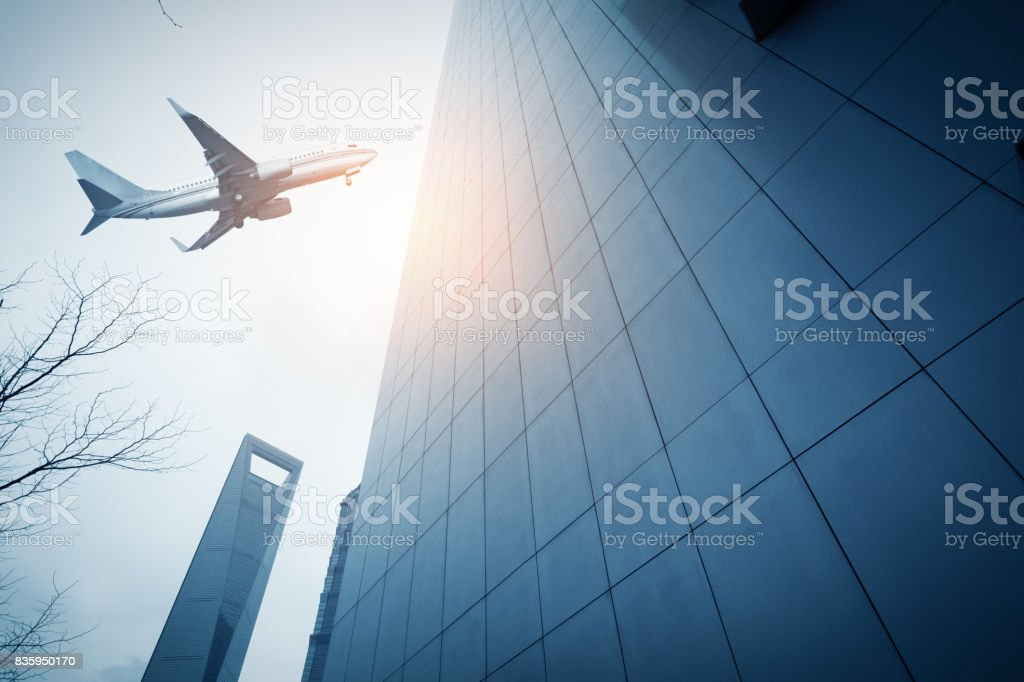 Shanghai's skyscrapers and airplanes on sky stock photo