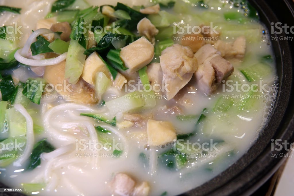 Shanghai-style braised noodles with diced chicken stock photo