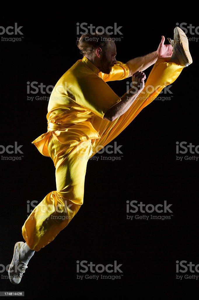 Shaolin Kung Fu warrior in midair stock photo