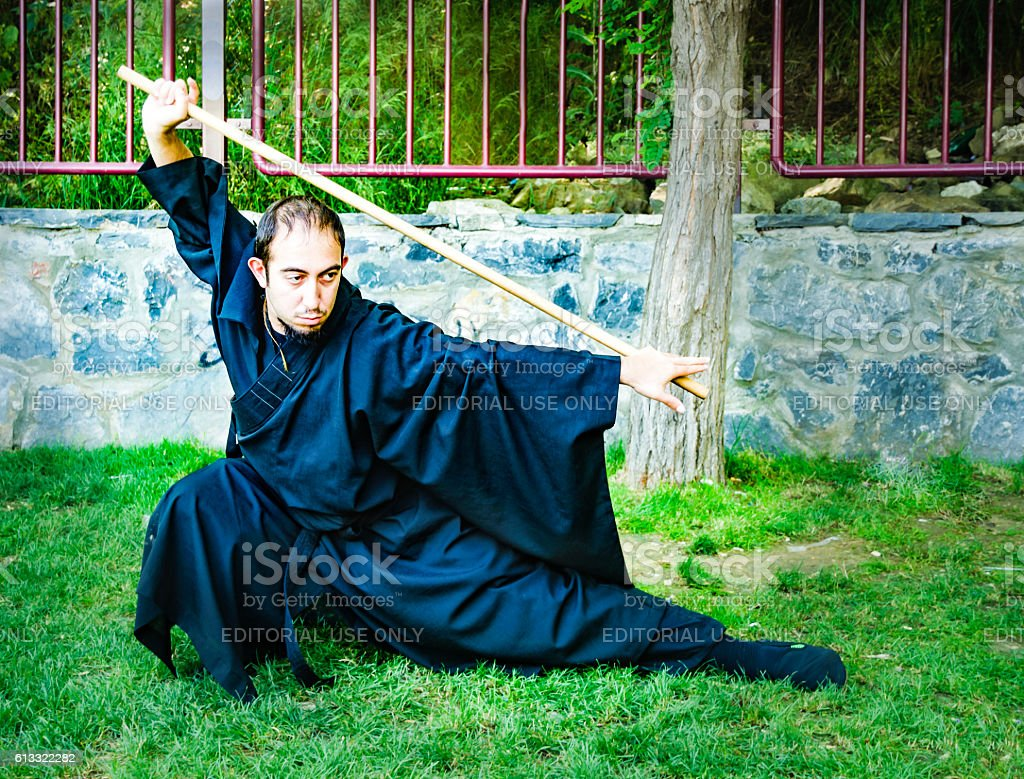 Shaolin Monk costume cosplay participants in the photo. stock photo