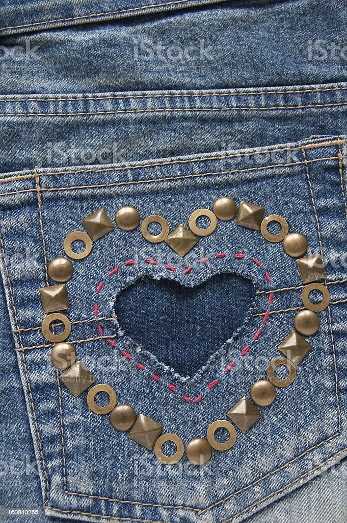 Shape of heart on a denim fabric royalty-free stock photo