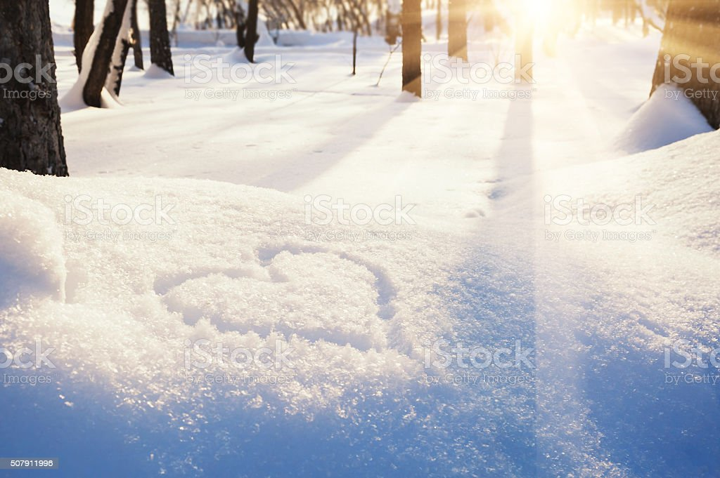 Shape of heart on the snow stock photo