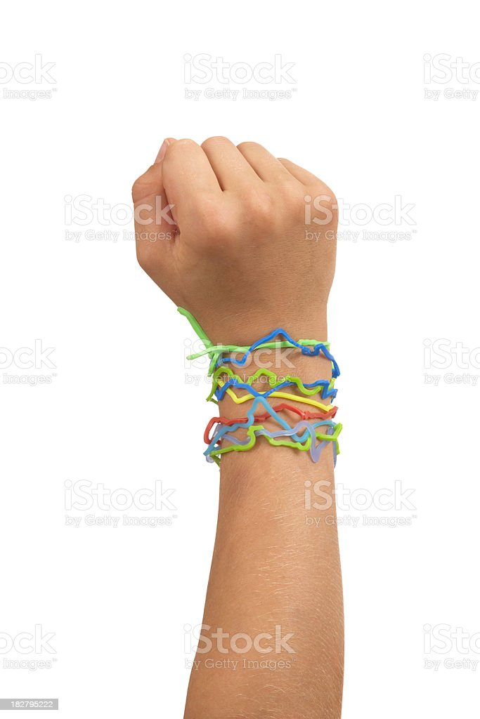 Shape Rubber Band Bracelets On Child's Arm / Hand In Fist royalty-free stock photo
