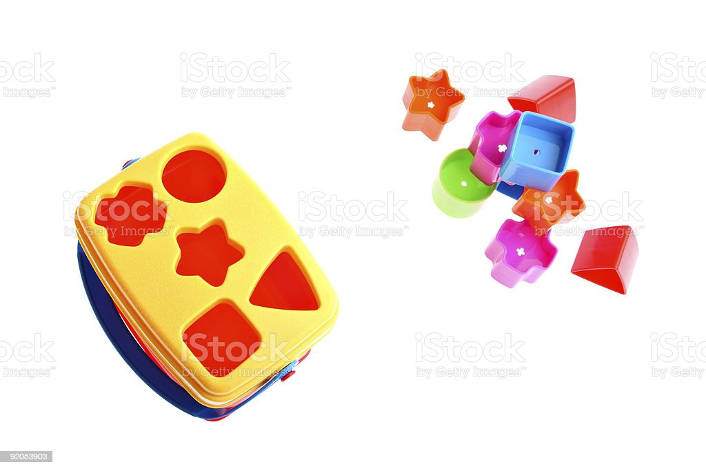 Shape sorter toy with various coloured blocks isolated on white royalty-free stock photo
