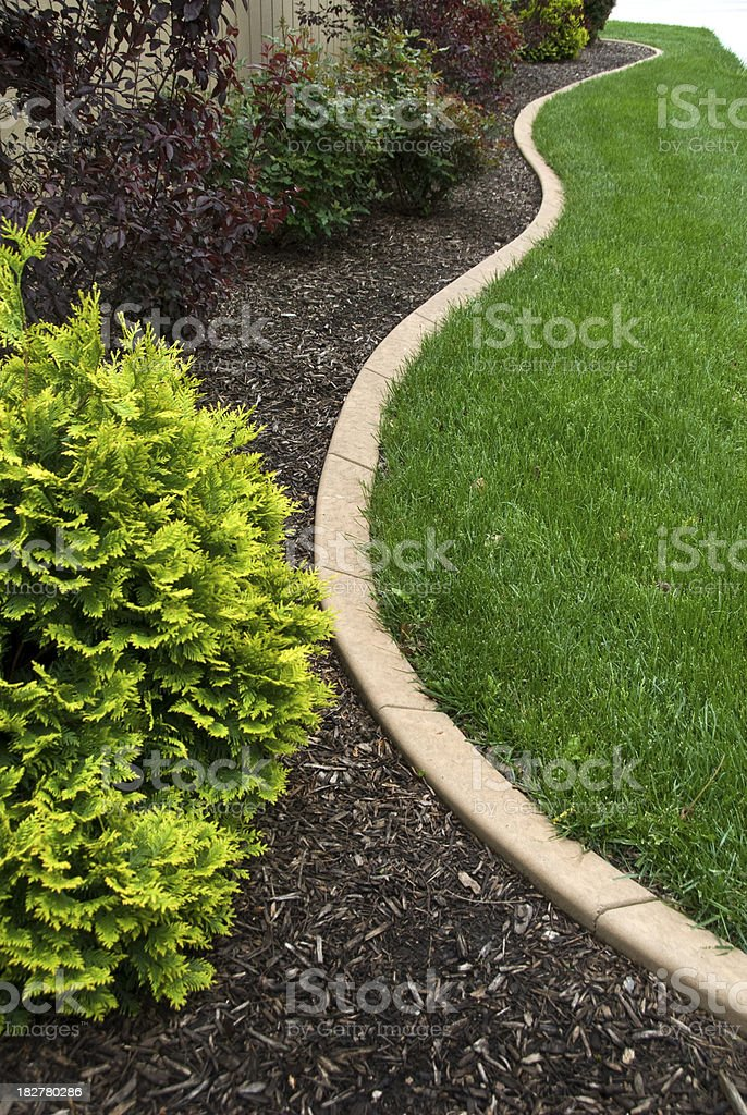 Shaped Concrete Curbing as Landscaping Edge stock photo