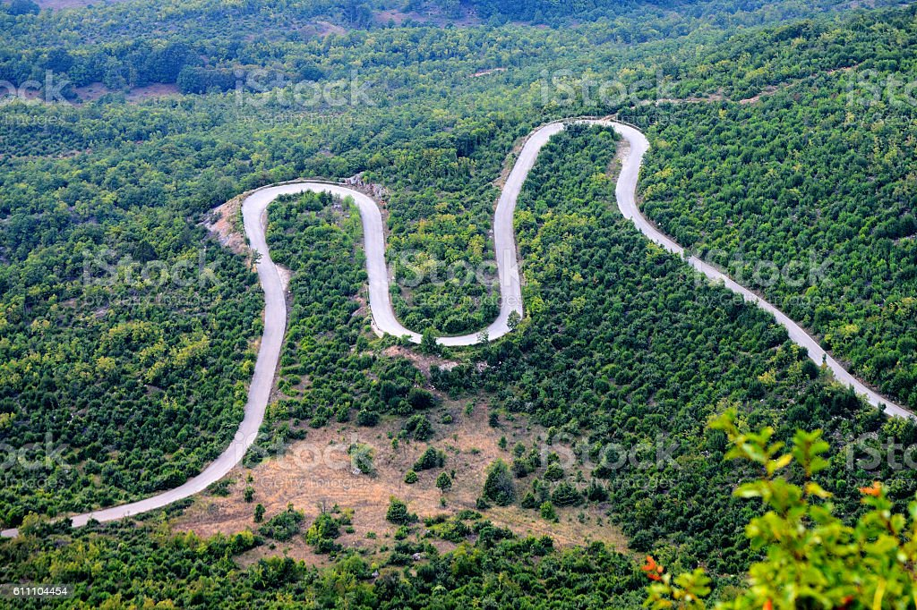 M shaped Winding Road through the woods stock photo