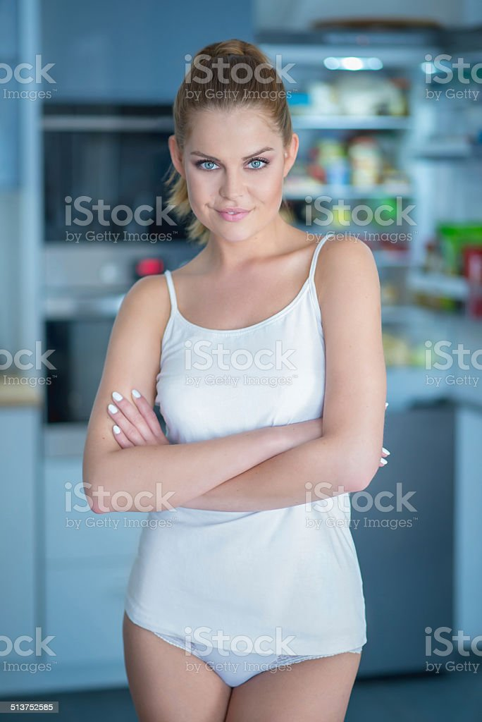 Shapely attractive young woman in sleepwear stock photo