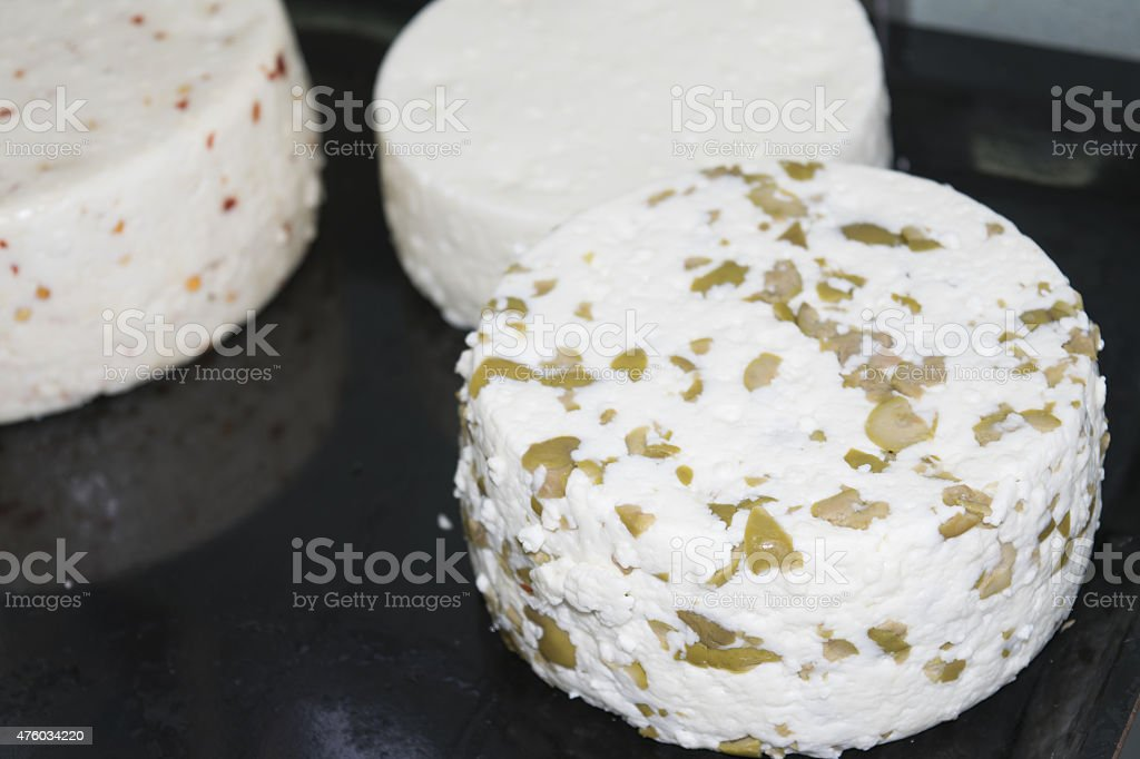 shapes of spiced  cheeses stock photo
