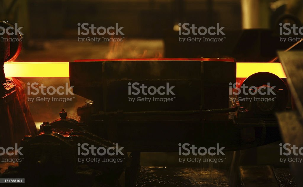 Shaping a hot metal in iron factory royalty-free stock photo