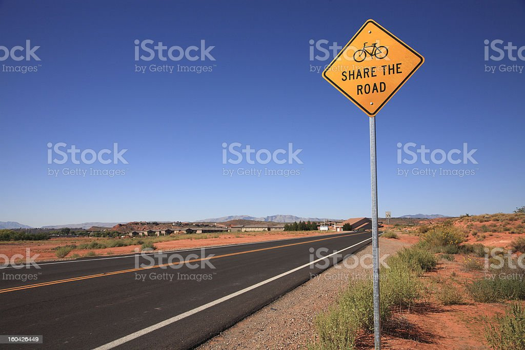 Share The Road Signage With Blue Sky Background royalty-free stock photo