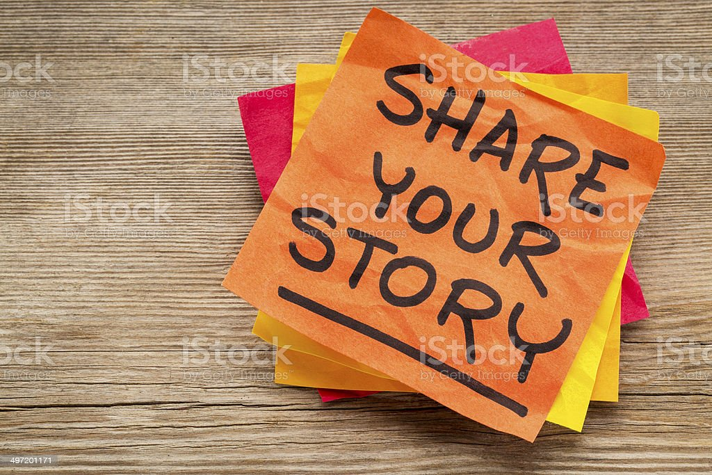 share your story on sticky note stock photo