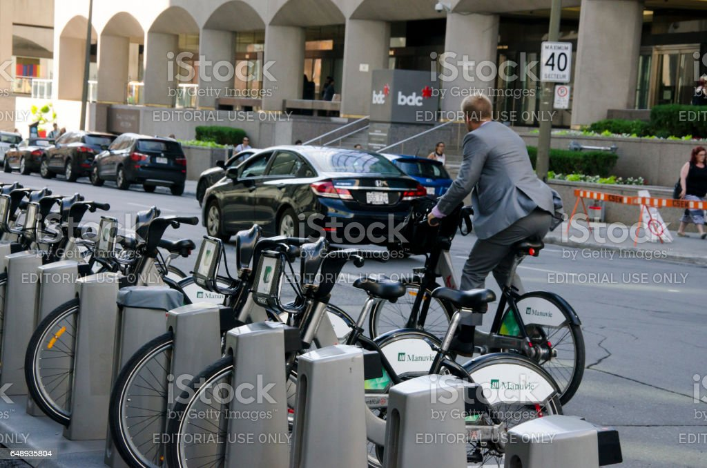 Shared bikes are lined up in streets stock photo
