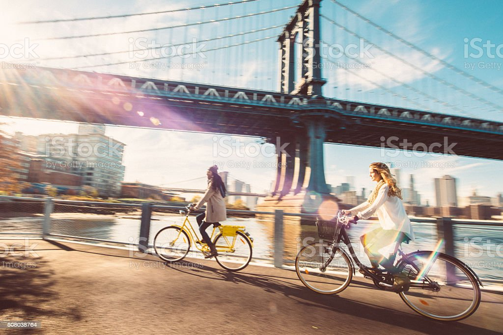 Sharing a Bicycle ride my friend in NYC stock photo