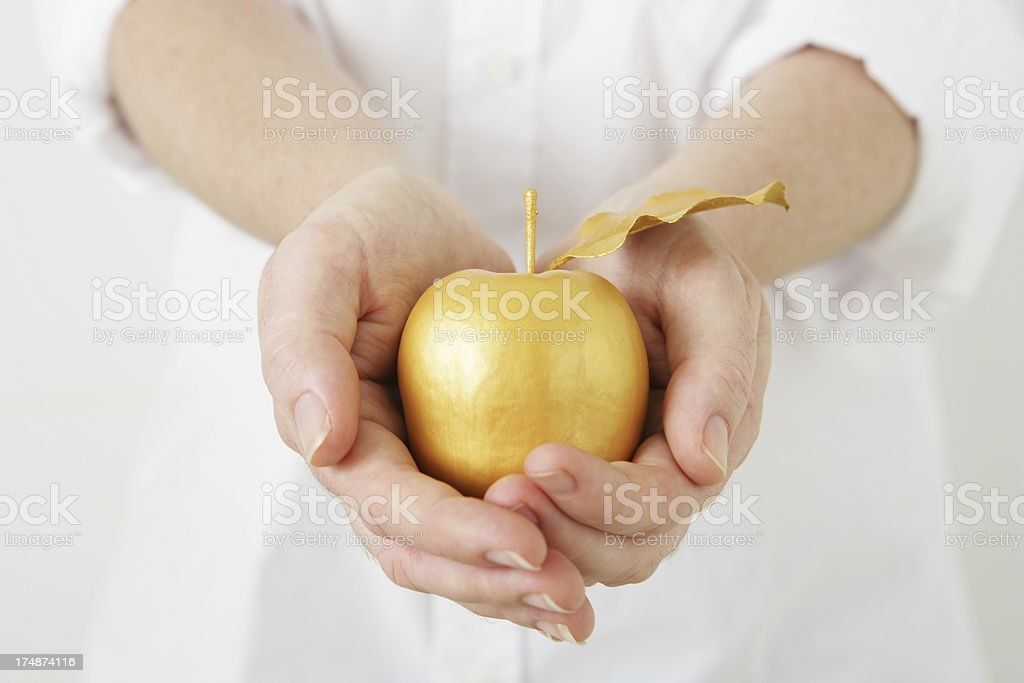Sharing a Golden Apple royalty-free stock photo