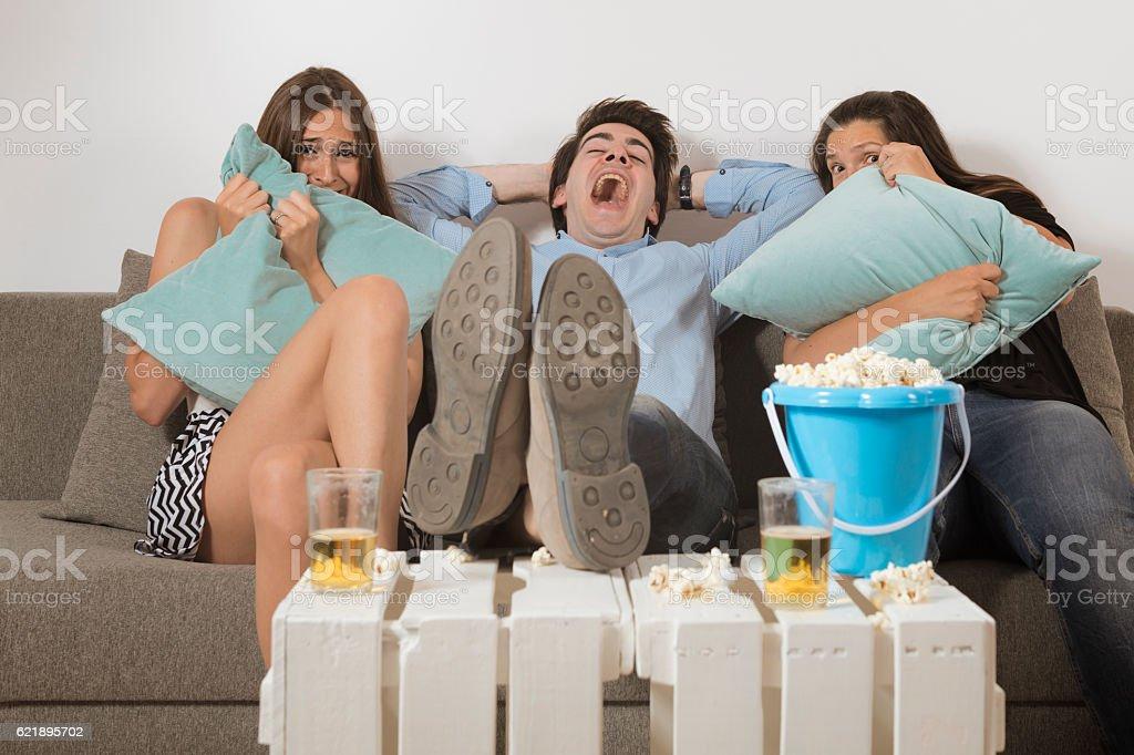 Sharing a horror movie stock photo