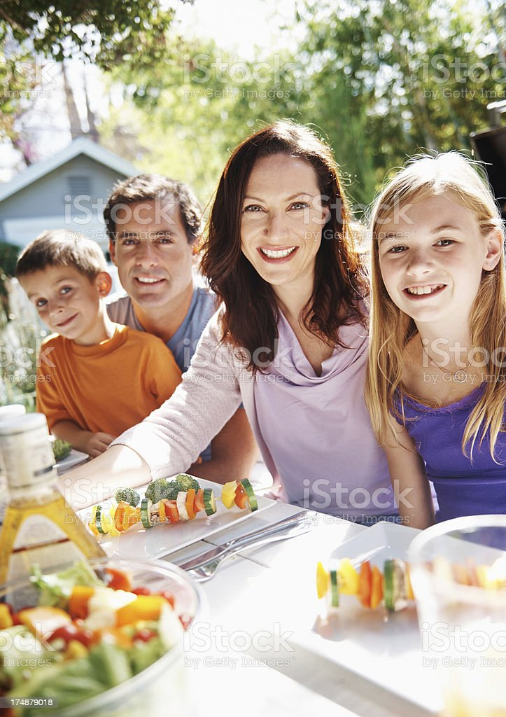Sharing a meal in the sunshine stock photo