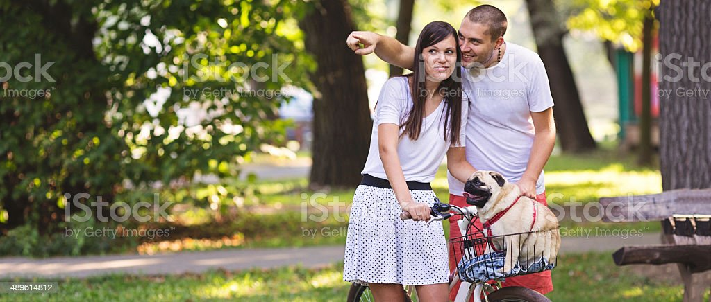 Sharing an intimate moment with pug-dog in the park stock photo