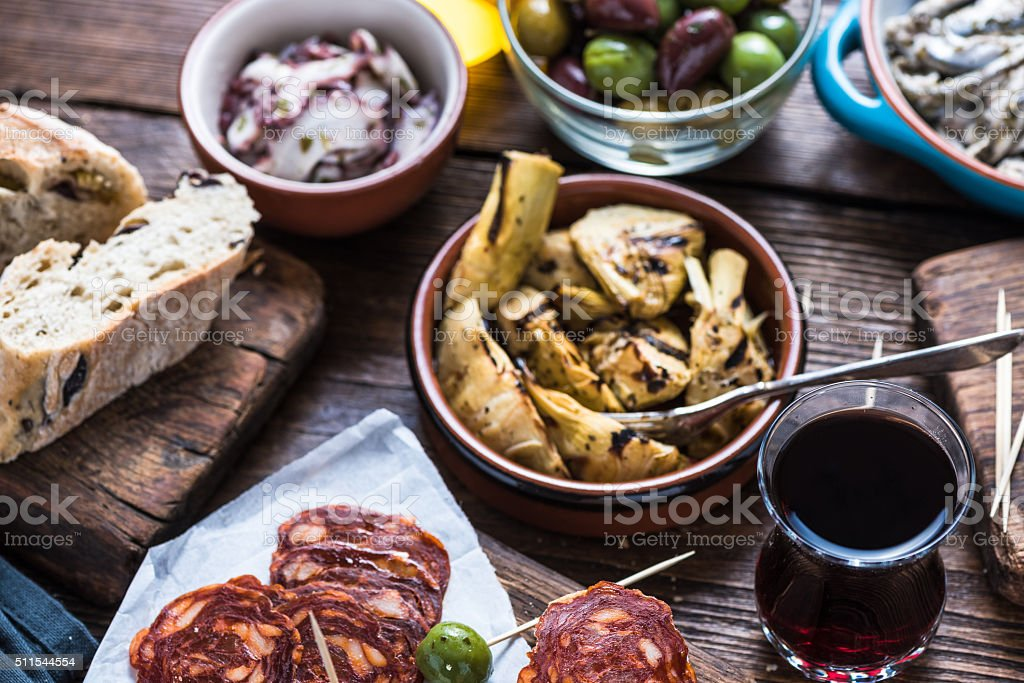 Sharing authentic spanish tapas with friends in bar stock photo