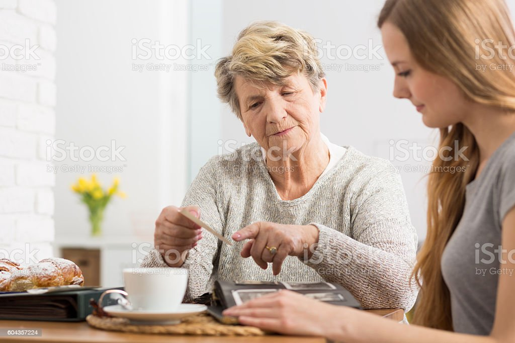 Sharing best memories with her granddaughter stock photo