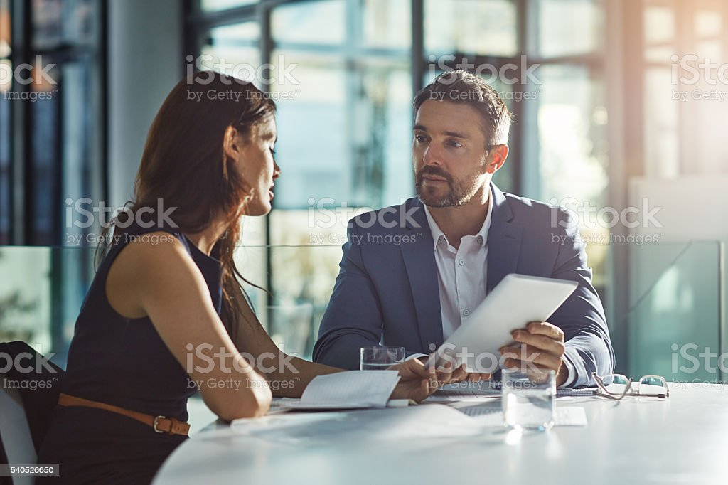 Sharing business solutions through technology stock photo