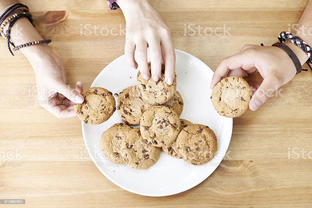 Sharing cookies stock photo