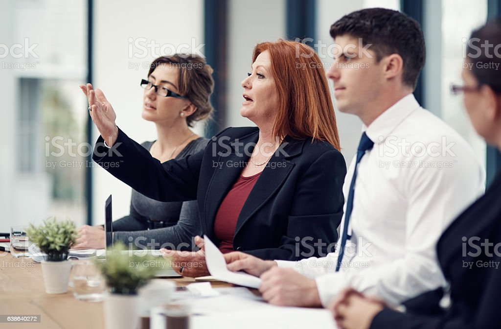 Sharing critique and criticism is vital for improving business stock photo