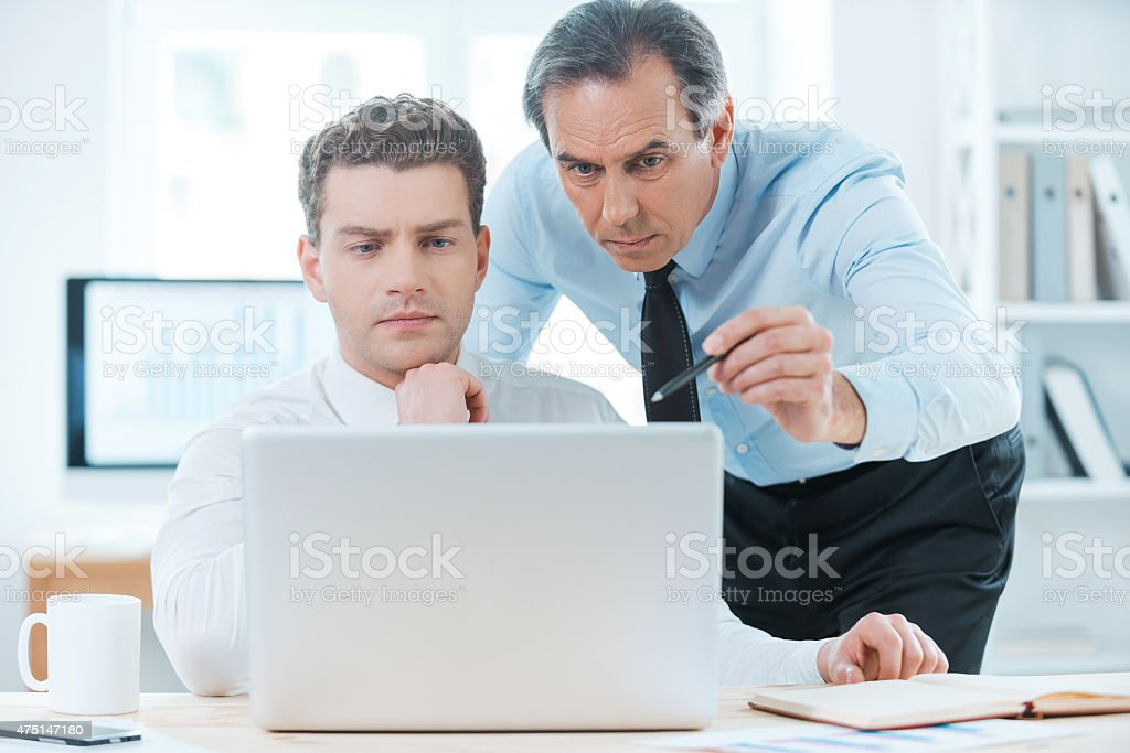 Sharing experience with colleague. stock photo