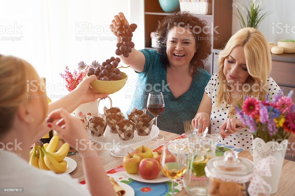 Sharing fruits with best friend stock photo