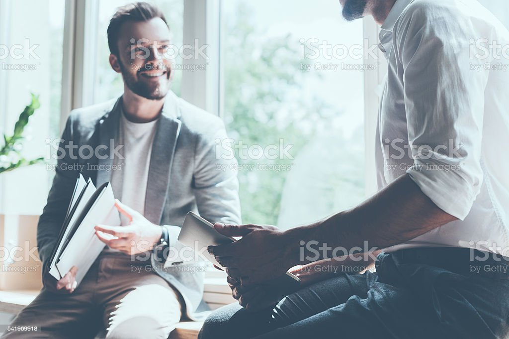 Sharing good news. stock photo