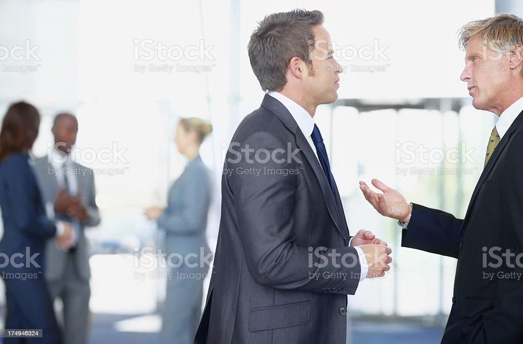 Sharing his corporate wisdom royalty-free stock photo