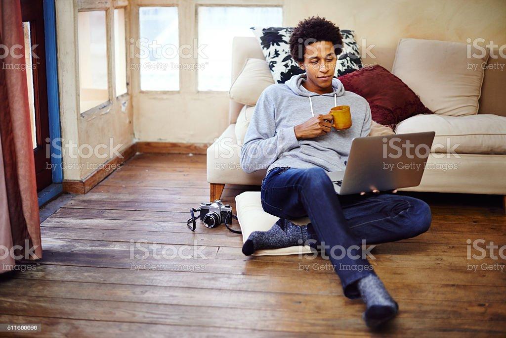 Sharing his hobby online stock photo