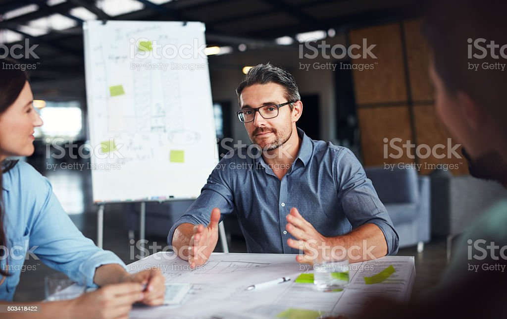 Sharing his idea stock photo