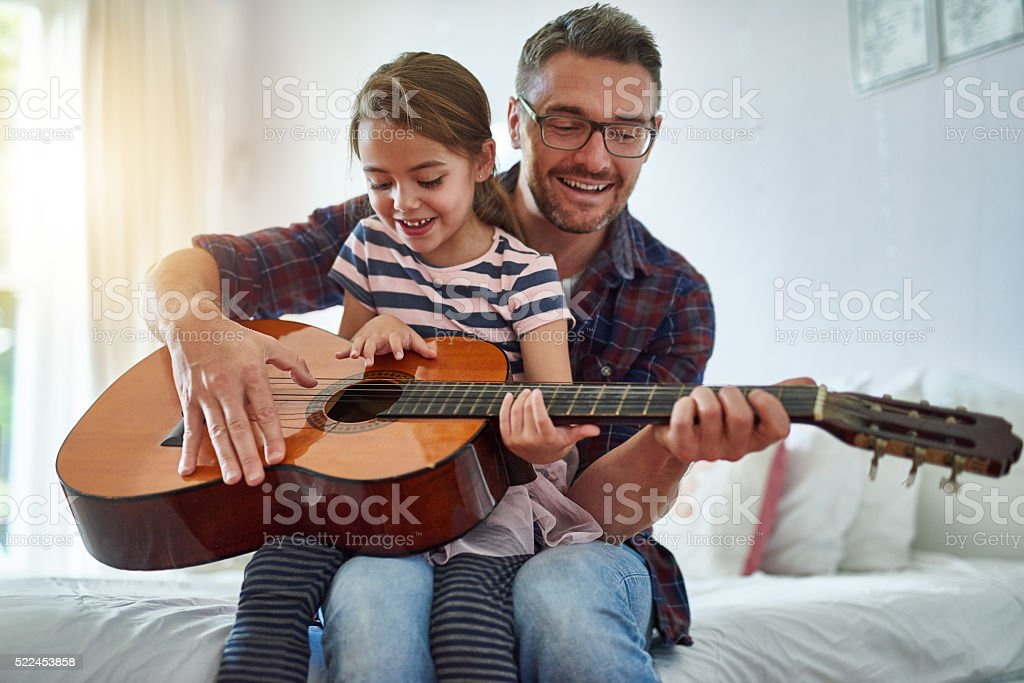 Sharing his passion with his daughter stock photo