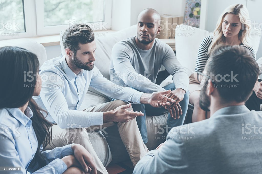 Sharing his problems with group. stock photo