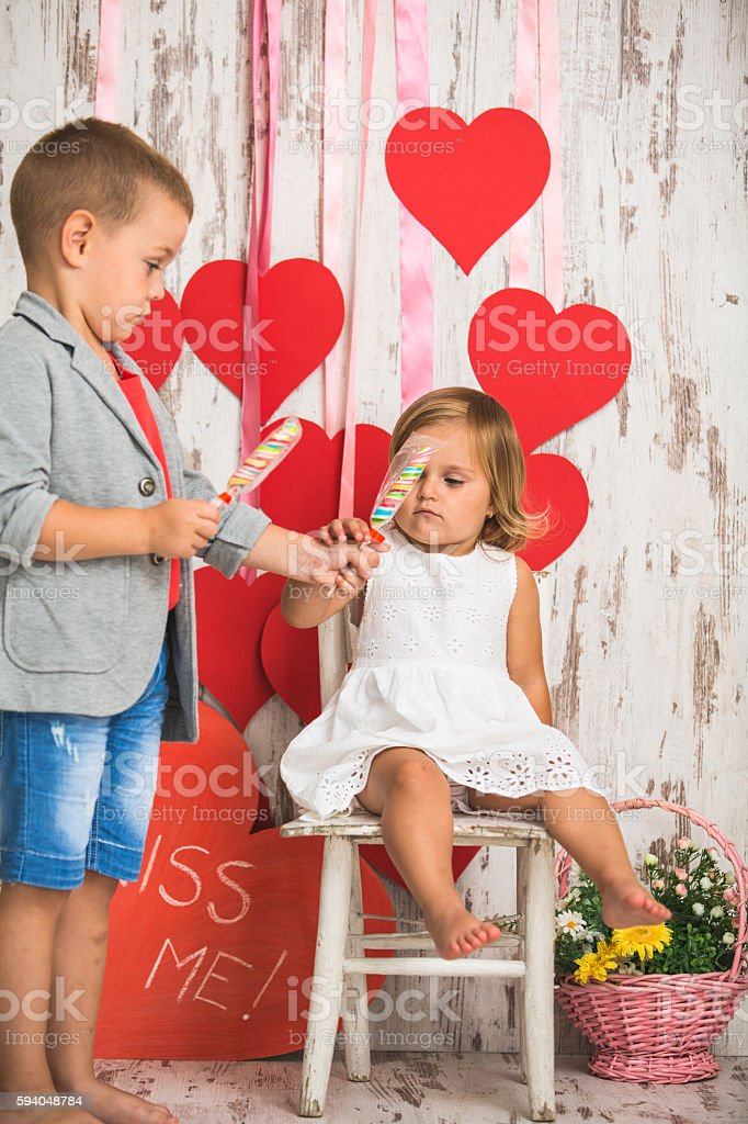 Sharing lollipops stock photo