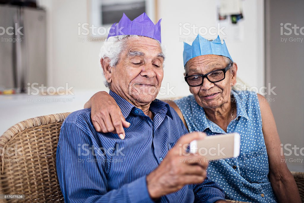 Sharing moments on the mobile phone for Christmas stock photo