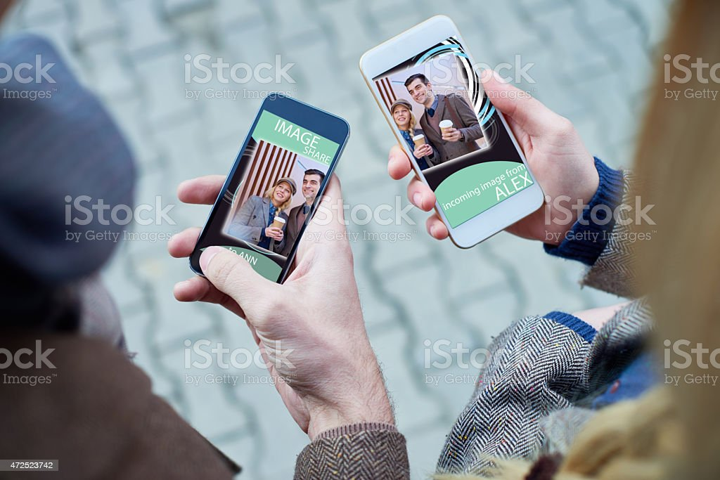 Sharing pictures stock photo