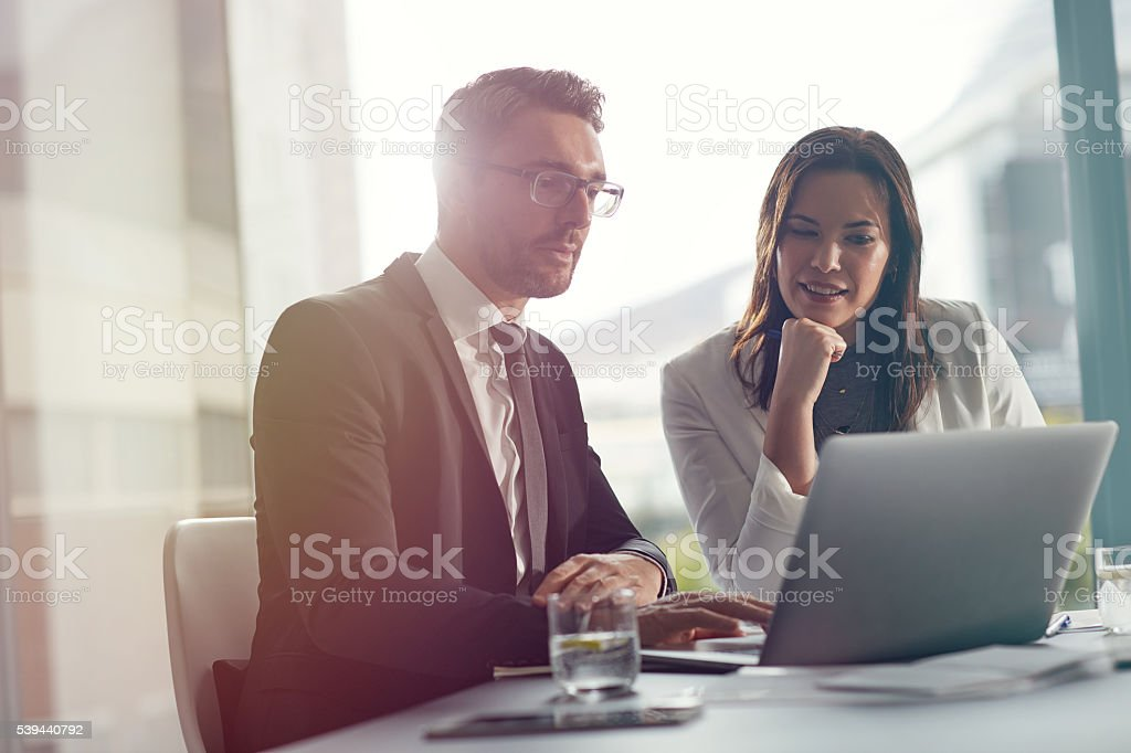 Sharing solutions through technology stock photo