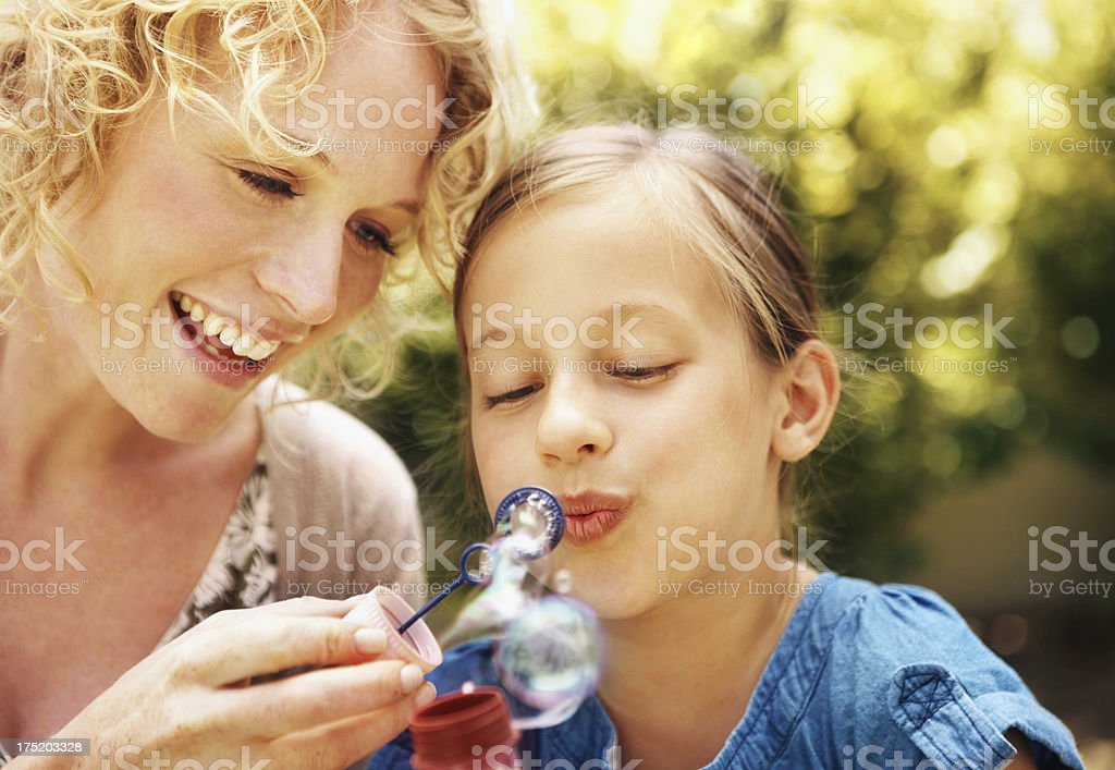 Sharing some fun in the garden royalty-free stock photo