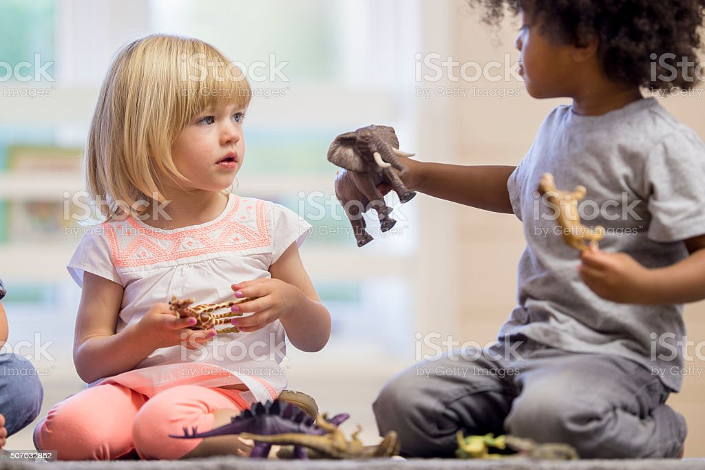 Sharing Toys stock photo