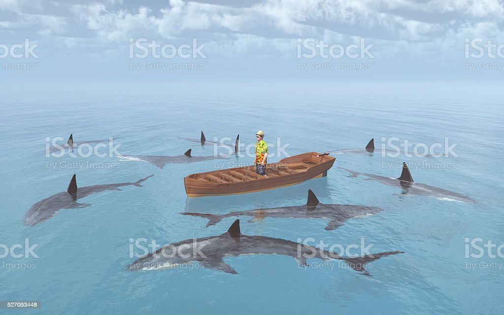 Sharks surround a man in a boat stock photo