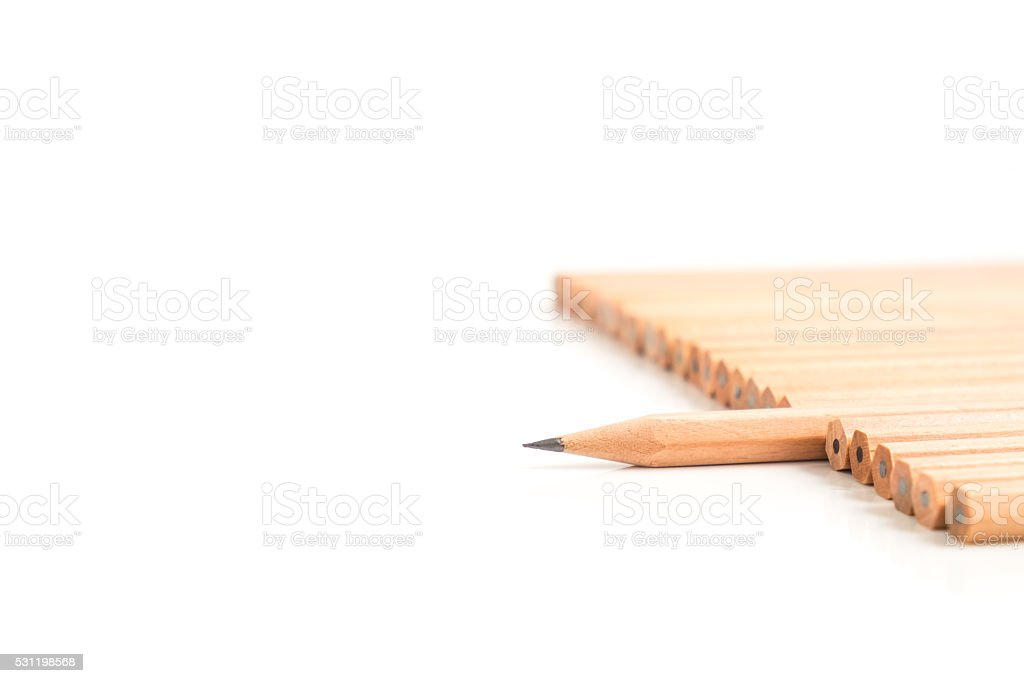 Sharp brown pencil stand out of the other brown pencils stock photo