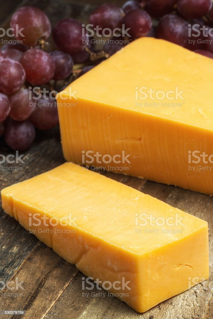 Sharp cheddar cheese stock photo