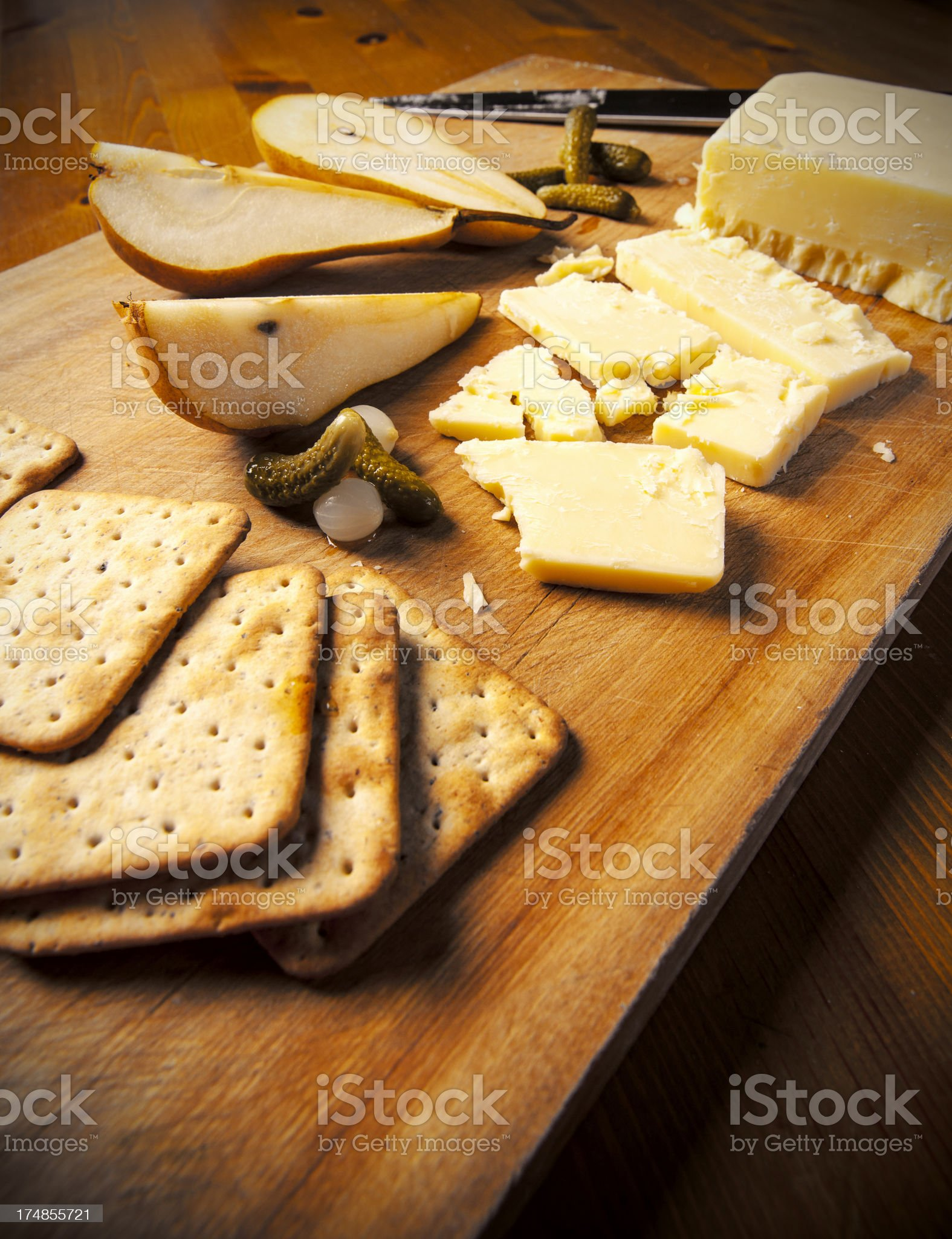 Sharp cheddar with pears royalty-free stock photo